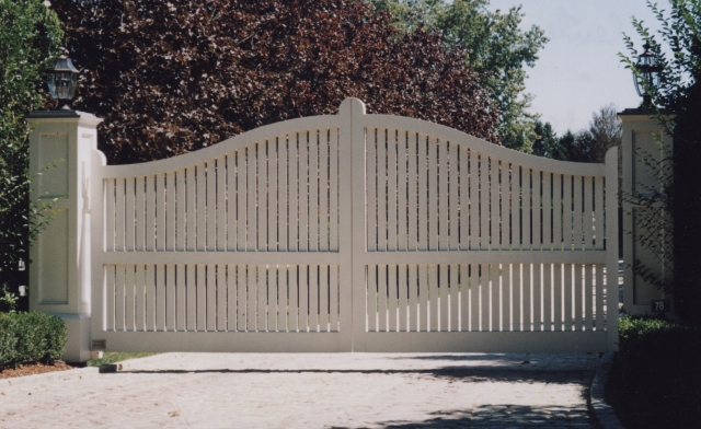 Montauk Convex wooden driveway gate with AZEK roof.